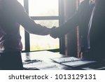 business partners handshaking... | Shutterstock . vector #1013129131