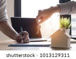 house key given by salesman ...   Shutterstock . vector #1013129311