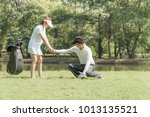 the trainer is teaching the... | Shutterstock . vector #1013135521