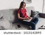 young woman using laptop at...   Shutterstock . vector #1013142895