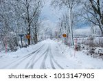 snowy country road with speed...   Shutterstock . vector #1013147905