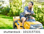 young gardener woman mowing the ... | Shutterstock . vector #1013157331