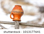 clay jugs on a wooden fence ... | Shutterstock . vector #1013177641