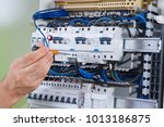 electrician at work with an... | Shutterstock . vector #1013186875