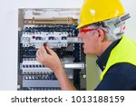 electrician at work with an... | Shutterstock . vector #1013188159