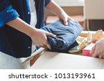 happy woman unpacking stuff in...   Shutterstock . vector #1013193961