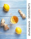 a cup of ginger tea with lemon... | Shutterstock . vector #1013219671