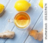 a cup of ginger tea with lemon... | Shutterstock . vector #1013219674