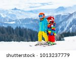 child skiing in the mountains.... | Shutterstock . vector #1013237779