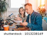 father and daughter sitting at... | Shutterstock . vector #1013238169