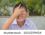 embarrassed the student boy... | Shutterstock . vector #1013259424