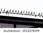 the metal spikes on top of a... | Shutterstock . vector #1013278399