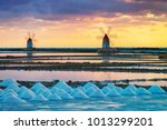 sunset at windmills in the salt ... | Shutterstock . vector #1013299201