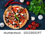 homemade pizza with tomatoes ... | Shutterstock . vector #1013303197