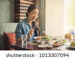 happy woman eating healthy... | Shutterstock . vector #1013307094