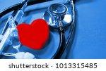 heart symbol and phonendoscope. ... | Shutterstock . vector #1013315485