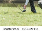 caddy puts the golf ball in the ... | Shutterstock . vector #1013329111