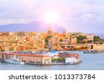 High angle view of Genoa (Genova) city with sea view and yachts under the bright sun in natural background. - stock photo