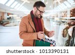 man in shopping. young man in... | Shutterstock . vector #1013390131