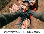 four crazy funny people selfie. ... | Shutterstock . vector #1013395507