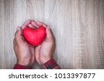 Small photo of hand holding a red heart, valentine's day love, vintage tone