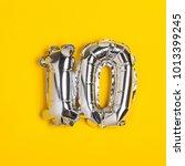 silver foil number 10... | Shutterstock . vector #1013399245