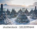 sunrise at borobudur temple ... | Shutterstock . vector #1013399644