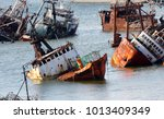 abandoneold rusty ships in the... | Shutterstock . vector #1013409349