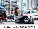 full length of an injured young ... | Shutterstock . vector #1013422735