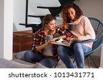two best female friends looking ... | Shutterstock . vector #1013431771