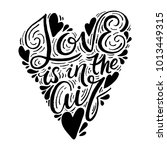 love is in the air. hand drawn... | Shutterstock .eps vector #1013449315
