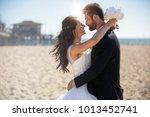 beautiful bride and handsome... | Shutterstock . vector #1013452741