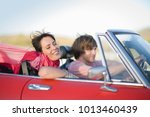 man and woman driving in a... | Shutterstock . vector #1013460439