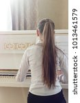 girl playing on white piano. a... | Shutterstock . vector #1013461579