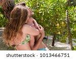 couple talking under tree on... | Shutterstock . vector #1013466751