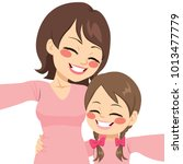 beautiful mother and daughter... | Shutterstock .eps vector #1013477779