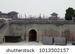 Small photo of Xian,Shanxi,China.August 17,2015.Tower on the Xian Circumvallation with many tourists walking and traveling in shanxi province China.