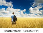 man in yellow wheat meadow.... | Shutterstock . vector #101350744
