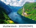 Breathtaking view of Sunnylvsfjorden fjord and famous Seven Sisters waterfalls, near Geiranger village in western Norway. - stock photo