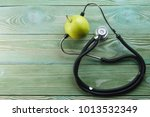 stethoscope and apple on a