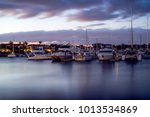Boats On Harbour At Sunset In...
