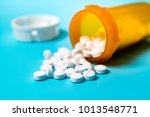 white pills in a yellow plastic ... | Shutterstock . vector #1013548771