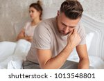 Small photo of Image of Sad unhappy couple having problem in bed