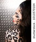 young sexy woman with leopard... | Shutterstock . vector #1013570104
