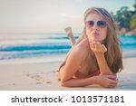 pretty long haired woman... | Shutterstock . vector #1013571181