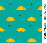 opened yellow umbrellas.... | Shutterstock .eps vector #1013572951