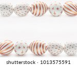 golden easter eggs row frame on ... | Shutterstock . vector #1013575591