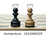 Small photo of Couple in a quarrel. Quarrel over pride, arrogance. A break up. Made of chess pawns, white and black. Emotions and crowns are painted.