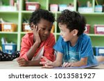 american and african boys are... | Shutterstock . vector #1013581927