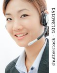 Beautiful asia young business woman with headset - stock photo